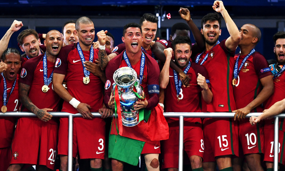 PARIS, FRANCE - JULY 10:  Cristiano Ronaldo of Portugal (c) lifts the Henri Delaunay trophy after his side win 1-0 against France during the UEFA EURO 2016 Final match between Portugal and France at Stade de France on July 10, 2016 in Paris, France.  (Photo by Mike Hewitt/Getty Images)